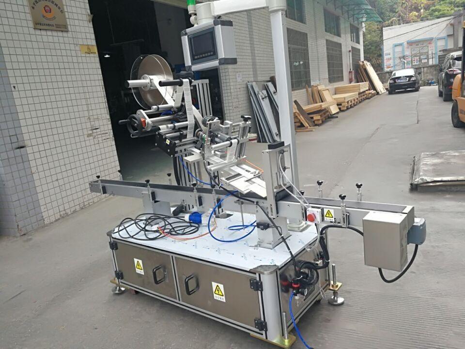 ノズルポーチ電動式用ステッカートップラベル機